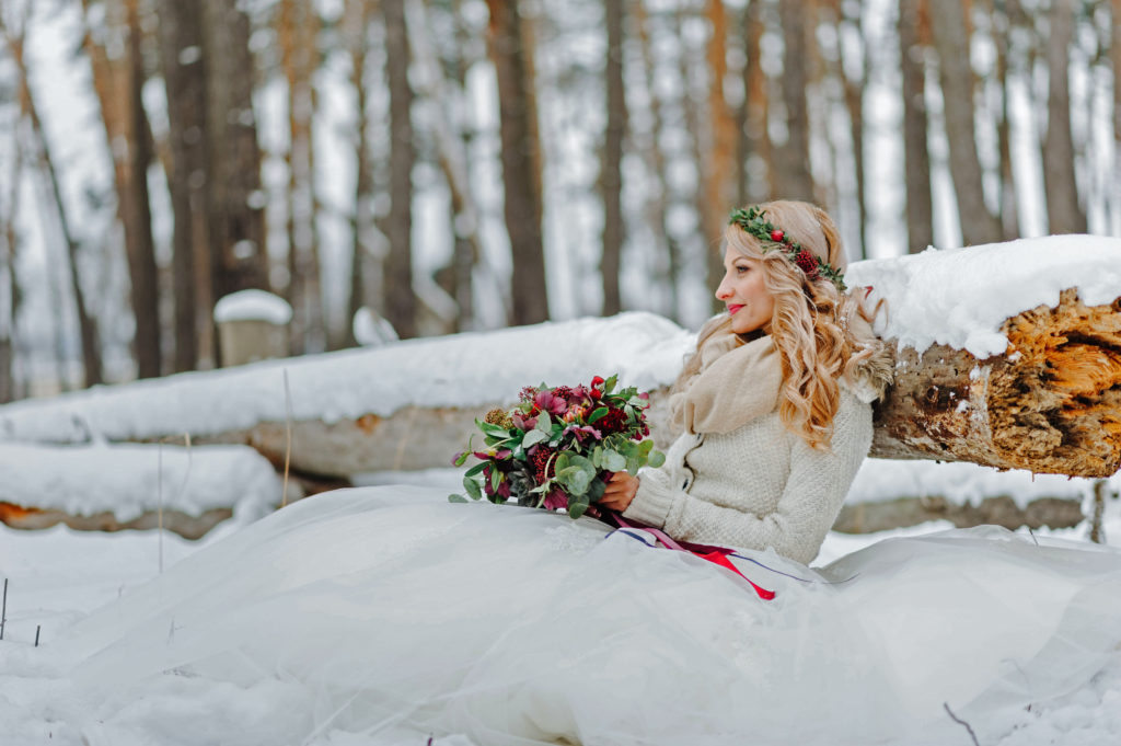 portrait of a bride in a winter forest